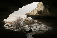 The grotto. The grotto with the frozen waterfall in winter stock photography