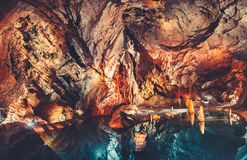 The grotto with the lake in the cave. The Tatras. royalty free stock photos