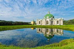 The Grotto Pavilion with reflection in water in park Kuskovo Royalty Free Stock Photography