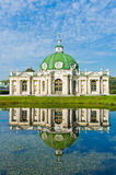 The Grotto Pavilion with reflection in water in park Kuskovo Royalty Free Stock Photo