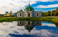 The Grotto Pavillon. Summer palace of russian Prince reflected in a pond. Kuskovo manor. Moscow. Russia. Stock Photos