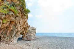Grotto in the rock on the beach Royalty Free Stock Image