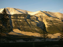 Grotto with sunset lights. Close up of grotto mountain in Canmore, in winter ast sunset stock photos