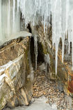 Grottoes and cracks in the rock with icicles. Stock Image