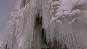 Grottoes and cracks in the rock with icicles stock footage video stock video