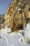 Grottoes and icicles on the rocks. Stock Photo