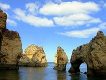 Grottos.Lagos. Rocky zone called Tip the very interesting Mercy for its grottos and point of view on the very interesting sea. In Lagos, Algarve.Portugal Stock Images