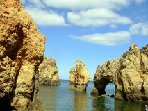 Grottos.Lagos II. Rocky zone called Tip the very interesting Mercy for its grottos and point of view on the very interesting sea. In Lagos, Algarve.Portugal Stock Photos