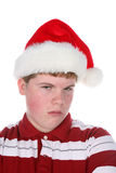 Grouchy teenage boy in stanta hat Royalty Free Stock Photos