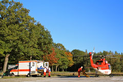 Ground and Air Ambulance working together. Paramedics crew taking over patient from rescue helicopter. Erlangen, Germany Stock Photo