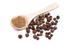 Ground allspice on wooden spoon Royalty Free Stock Photos