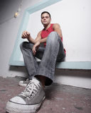 Ground angle view of a hip young man Royalty Free Stock Photo