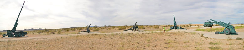 Ground Artillery - Panorama. A panoramic view of a public displayed military ground artillery. Found near  the Yuma Proving Ground, a United States Army facility Royalty Free Stock Image