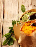 Ground Asian spices in paper bags Stock Photo