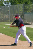 A Ground Ball in Practice. A Coach of the Minnesota Twins is hitting ground balls to team members. This practice is a staple of all baseball teams practicing royalty free stock photos