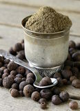 Ground black pepper. On a wooden table stock photography