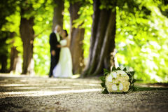 Ground bouquet with blurred couple Stock Photography