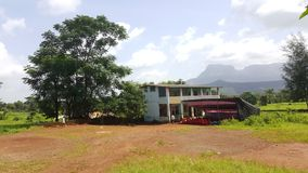 A rural village school in natural surrounding in India. Ground and building of a simple higher secondary school in a remote village of Maharashtra, India royalty free stock photography