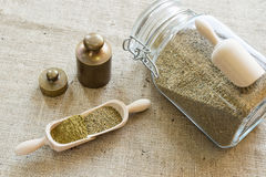 Ground celery seed. With jar full of seeds stock photography