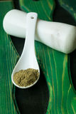 Ground celery seed. In white ceramic spoon stock image