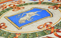 Galleria Vittorio Emanuele II beautiful mosaic Milan Italy. On the ground of the central octagonal, there are four mosaics portraying the coat of arms of the royalty free stock photo
