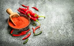 Ground chili peppers in a bowl. Stock Photos
