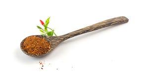 Ground chilli on white Stock Image