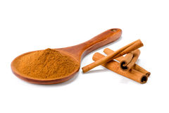 Ground cinnamon. On the spoon isolated on white background stock photography