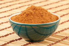 Ground cinnamon in bowl Royalty Free Stock Images