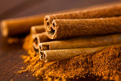 Ground cinnamon and cinnamon sticks Royalty Free Stock Image
