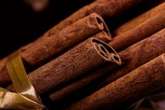 Free Ground Cinnamon, Cinnamon Sticks, Connected With A Tray With A Bow On A Color Background In A Rustic Style. Macro Photo Royalty Free Stock Photos - 101137578