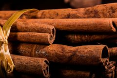 Free Ground Cinnamon, Cinnamon Sticks, Connected With A Tray With A Bow On A Color Background In A Rustic Style. Macro Photo Stock Image - 101137971