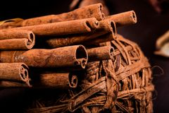 Free Ground Cinnamon, Cinnamon Sticks, Connected With A Tray With A Bow On A Color Background In A Rustic Style. Macro Photo Royalty Free Stock Photography - 101139297