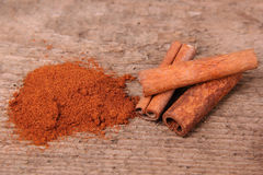 Ground Cinnamon and Cinnamon Sticks Stock Images