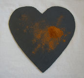 Ground cinnamon displayed on a heart shaped slate Stock Images