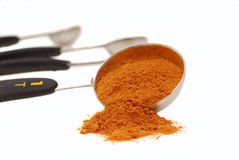 Ground cinnamon in a measuring spoon Stock Photo