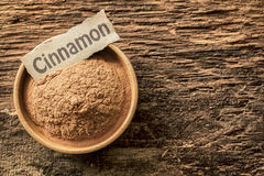 Ground cinnamon with a name tag Royalty Free Stock Photos