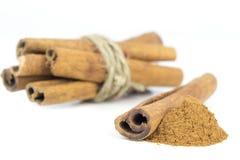 Ground Cinnamon and Sticks Stock Photo