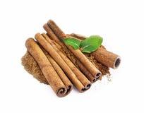 Ground cinnamon and sticks isolated Stock Photo