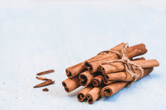 Ground cinnamon, sticks, tied with jute rope on old wooden background, selective focus, space for text, instagram filter Stock Image