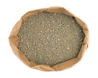Ground clay cat litter in an opened bag Stock Photo