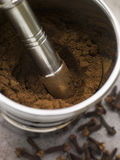 Ground Clove Powder in a Pestle and Mortar. High angle view of Ground Clove Powder in a Pestle and Mortar Stock Images