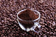 Ground coffee. Freshly ground coffee in a glass cup royalty free stock images