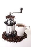 Ground coffee. Photograph of a coffee grinder with beans and a cup of black coffee Stock Photo