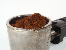 Ground coffee. In coffe machine spoon over light background Royalty Free Stock Photo