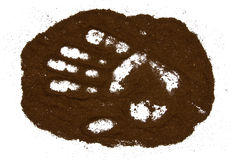 Ground coffee. Palm print in ground coffee stock image