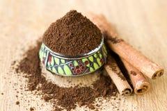 Ground Coffee And Cinnamon Sticks Stock Photography