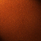Ground coffee background with beam of light Royalty Free Stock Image