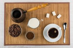 Ground coffee, beans, turka, milk, sugar, cup with drink Stock Photos