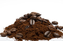 Ground coffee. With beans on white background royalty free stock images